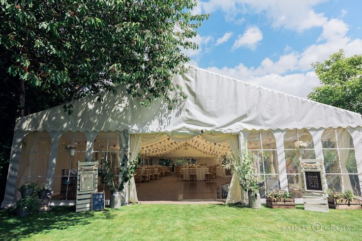 Our new 9m wedding marquee fitting perfectly into a pretty cottage garden. #cottagegardenwedding #marqueewedding #summerwedding