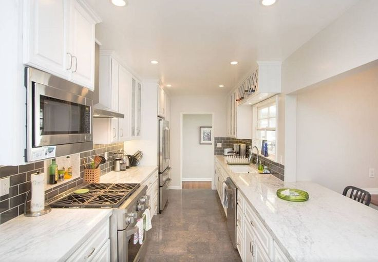 Cottage Kitchen with Stone Tile, Slate Tile, Raised panel, Complex marble counters, High ceiling, Calacatta Borghini, Marble.