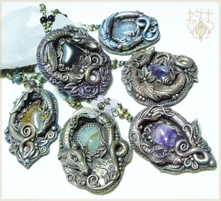 These dragons were modeled by hand in polymer clay, pigments and illuminated with antiqued. The dragons are guardians of semi-precious stones, and each dragon expresses the character of the stone i...