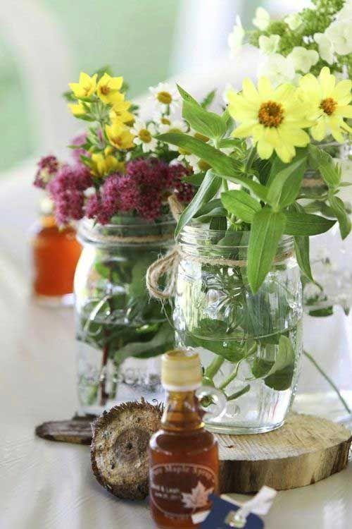 humble flowers and mason jar vases =15 Amazing DIY Wedding Centerpieces | Something Borrowed Wedding DIY