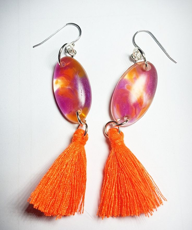 Handcrafted Resin piece with tassel on Sterling Silver hooks.
