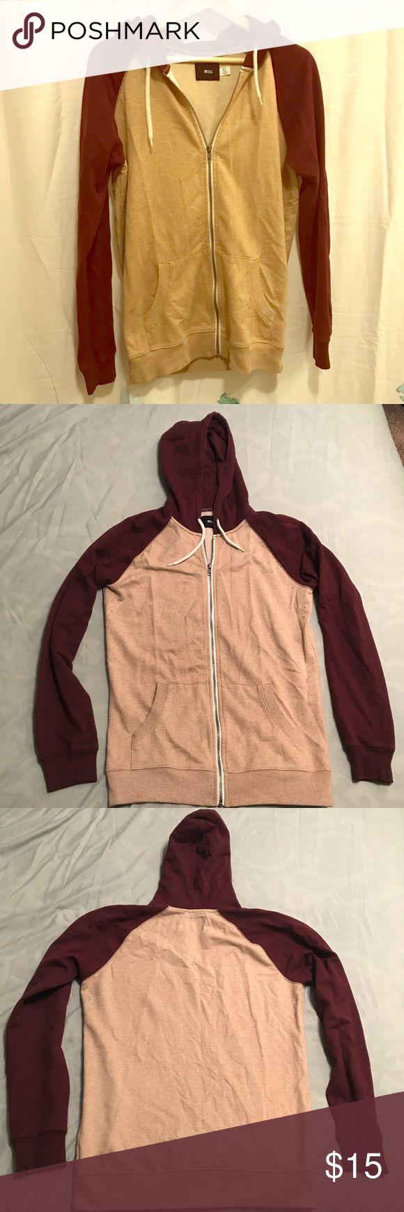 Beige and Maroon BDG zip up hoodie Metal zipper, maroon hood and sleeves. 67% Cotton, 33% Polyester BDG Sweaters