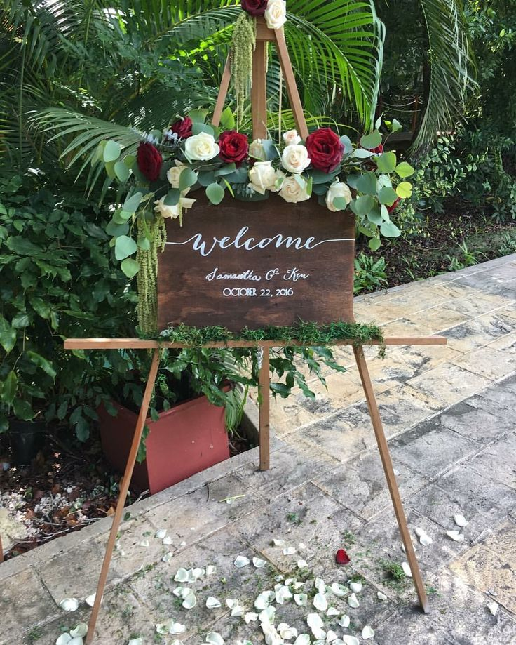 CBS119 weddings Riviera Maya easel and welcome Board with flower decor, red marsala, white and greenery
