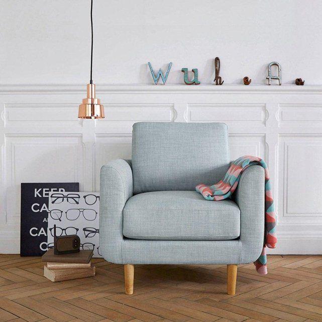 Le fauteuil Jimi. Coloris pastels et accueil très moelleux, ce fauteuil s'associera parfaitement à un salon d'inspiration nordique avec des meubles aux tons clairs pour un intérieur doux et cosy.