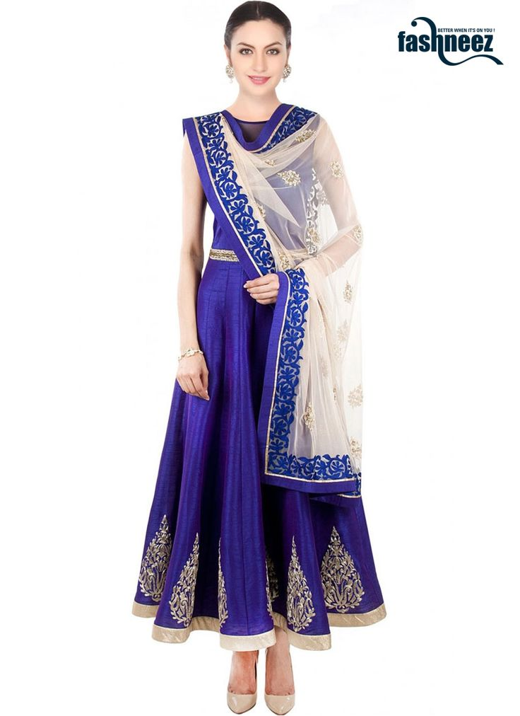 Be the dazzling diva clad in this blue net and raw silk anarkali salwar kameez…