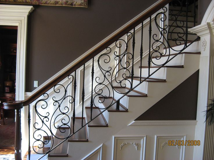 pretty swirly wrought iron stair railing.