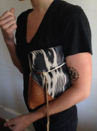 T R A V E L collection Leather and cotton clutch, cream color. $60.00, via Etsy.