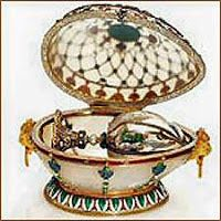 """This egg perfectly fits into the """"Renaissance Egg"""", and has similar decorations.  The """"Renaissance Egg"""" was confiscated by the Russian Provisional Government in and sold to Armand Hammer. After that, the egg was sold to the  dealers """"A La Vieille Russie"""" where it was purchased by Malchom Forbs for his collection in. In 2004 the Forbes collection was sold to Viktor Vekselberg. The egg finally got to return home to Russia to the Svyaz' Vremyond Fund."""