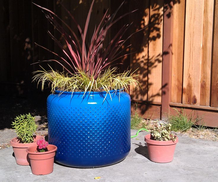 Purpose: Re-purpose salvaged materials to add a unique feature to your garden.  Tools: virtually none Materials: old washer drum, spray paint, rocks, ...