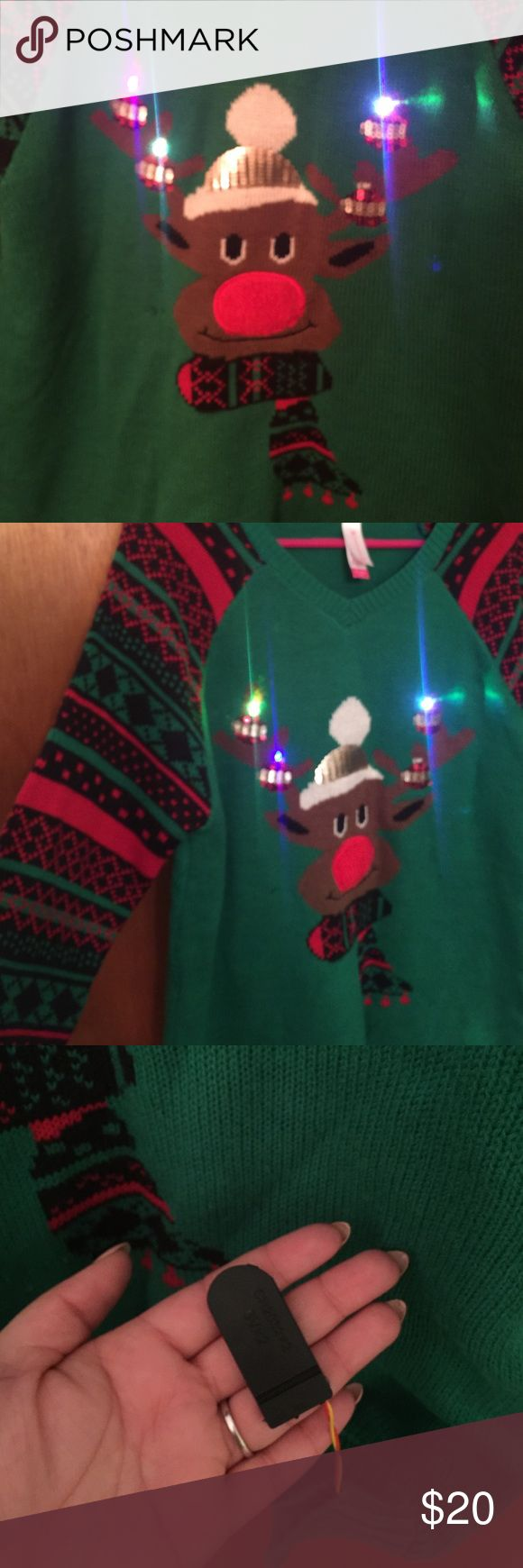 UGLY CHRISTMAS SWEATER LIGHT-UP Sweater lights up and has a switch inside (see photo)  Purchased on sale where returns weren't allowed and was too big, never worn for extended period Sweaters V-Necks