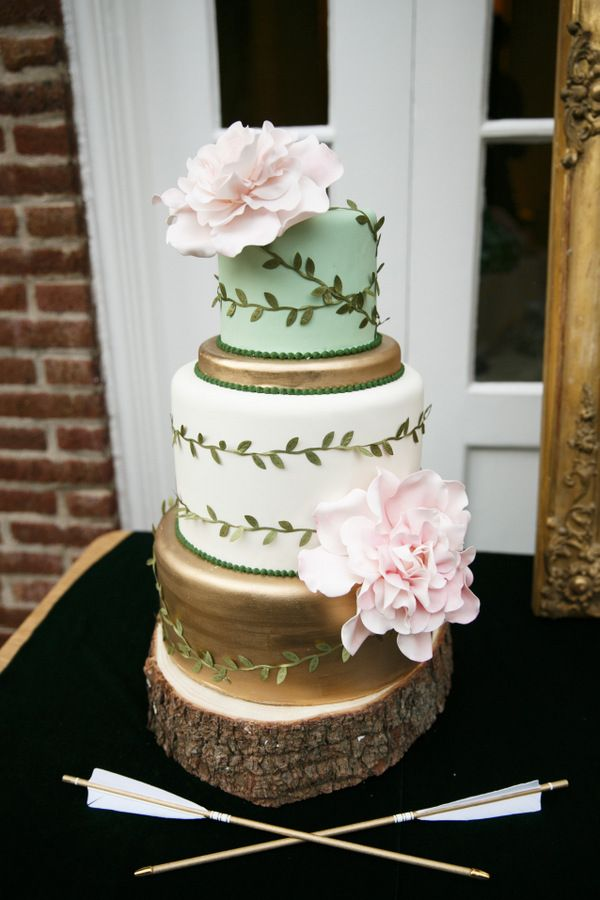 This beautiful cake by Mary at Cake (Chicago), did an amazing job tying in our colors of green and gold with a touch of blush pink. And don't you just love the arrows by Fletcher and Fox?!