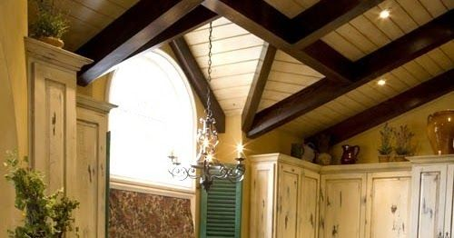 I find the elements in French country kitchens very appealing: exposed beams, distressed wood cabinets, stone or stucco walls...   large ...