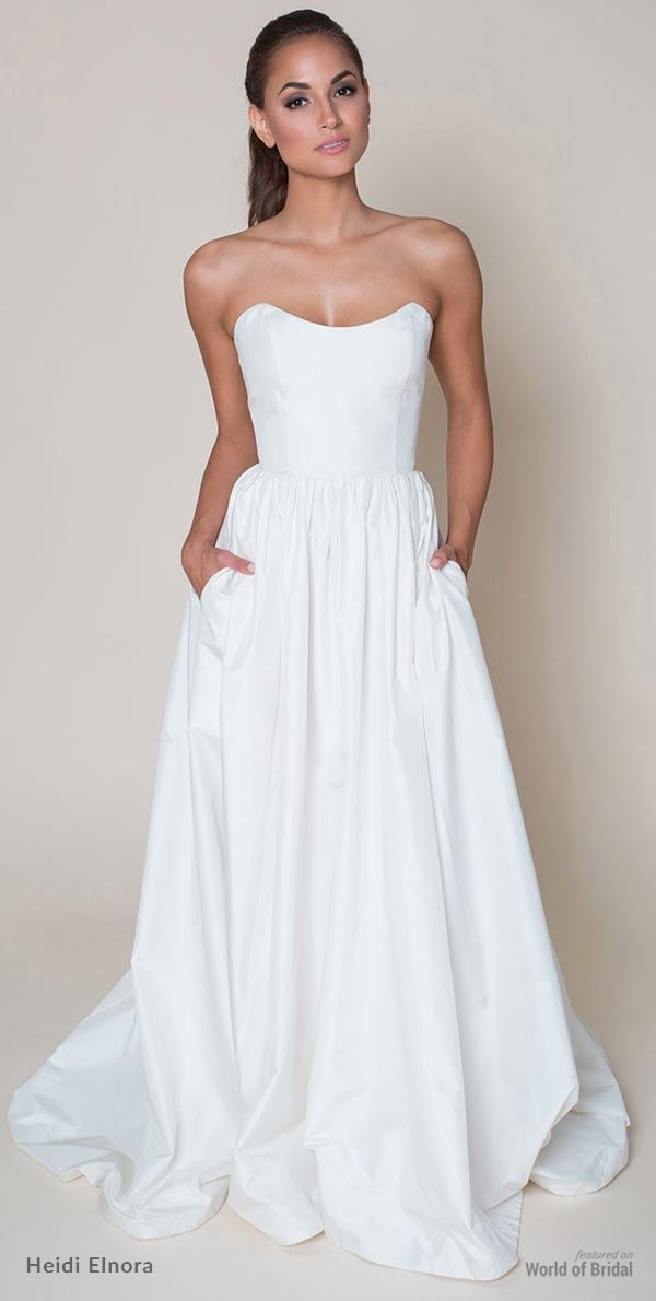 Simple and fresh, this A-line wedding dress features a scoop neckline, natural waist, gathered skirt with pockets, and a chapel train. The lightweight skirt is great for an outdoor spring ceremony!