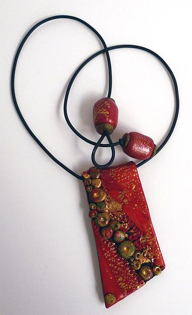 Red Pendant by Pati B. Lovely...Polymer Clay but would be wonderful in fabric.