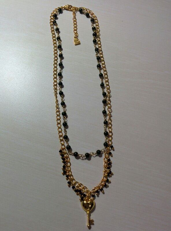 Gold heart key with black seed beads