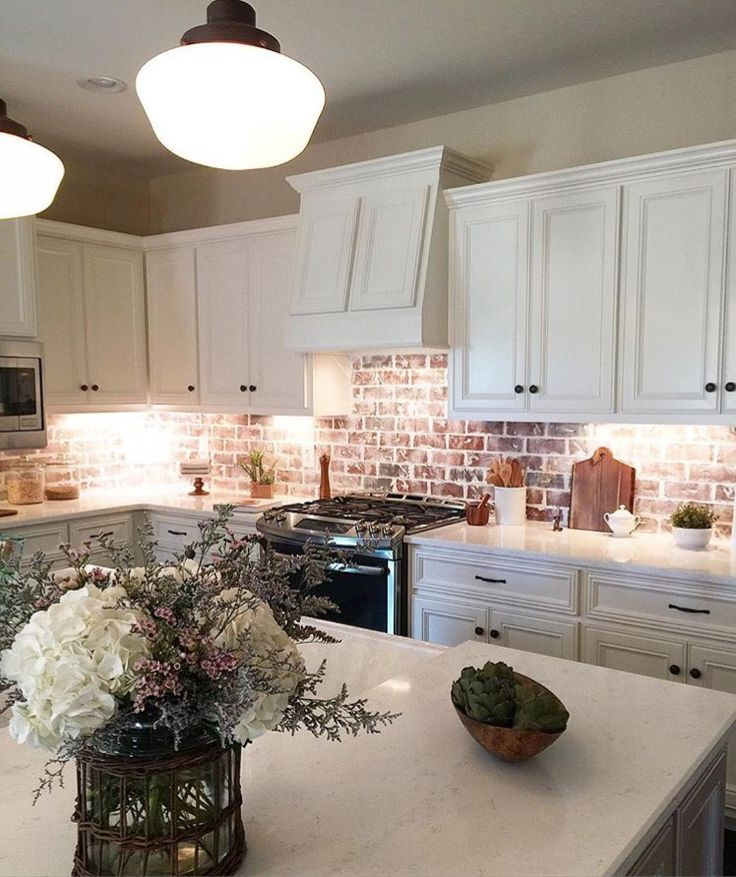 Create An Elegant Statement With A White Brick Wall Brick Kitchen Brick Backsplash Kitchen Kitchen Remodel