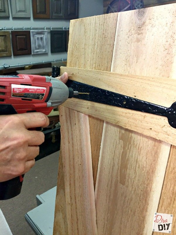 These cedar board and batten shutters are easy enough for the beginning DIYer. This is an Easy DIY to add dramatic character to you outside curb appeal.