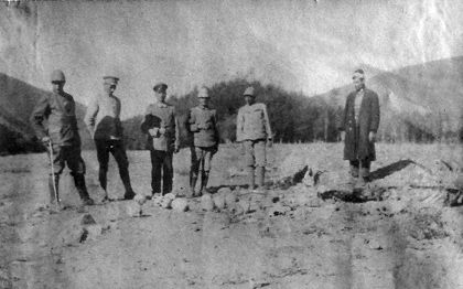 The German and Turkish officers posing to take photographs with skulls of the Armenian victims