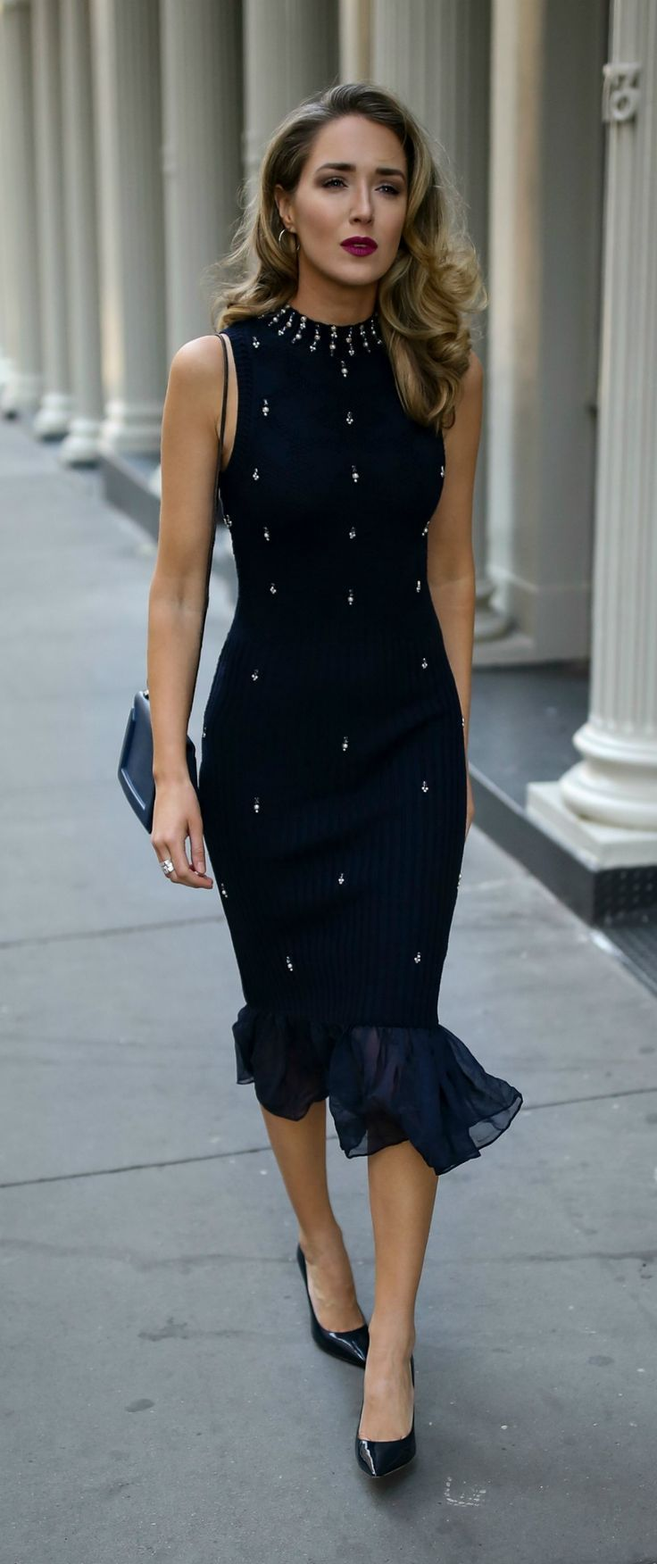 Dark blue ribbed midi dress with pearl and crystal embellishments in classic