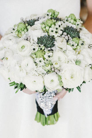 White ranunculus, cacti, and ornithogalum were fashioned into an elaborate bouquet. | Flowers by Vatel Manila | www.BridalBook.ph