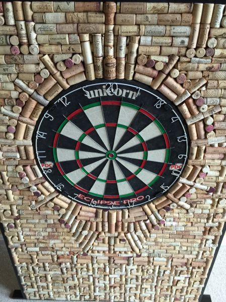 dart board cork wall..,.. and someone with artistic flair...