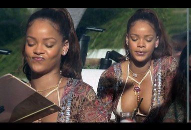 Rihanna shows off ample cleavage in bikini while poolside in Miami