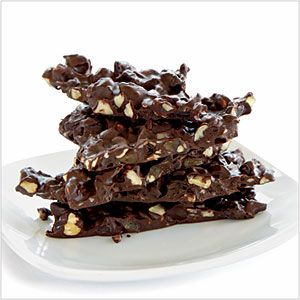 Power Chocolate Hazelnut Bark by cookinglight: So easily made and so special with bittersweet chocolate, crystallized ginger, dried cherries and hazelnuts! #Chocolate_Bark #cookinglight