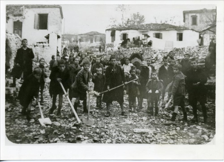 "Arta, Greece, 1944. ""Aetopoula"" (i.e. Young Eagles) served mainly as messengers of the Greek resistance organization EAM (i.e. National Liberation Front). Here Aetopoula clean debris in the north-western city of Arta, controlled by resistance forces, before the liberation of the country. Germans, Italians and Bulgarians of the Axis Triple Occupation forces never took full control of Greece during Occupation (April 1941-October 1944)."