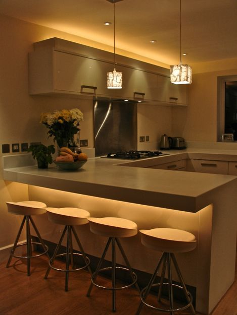 using strip lights to light above the cabinets gives the room height under the bar gives the room another focal point and decorative ceiling lighting ambient kitchen lighting