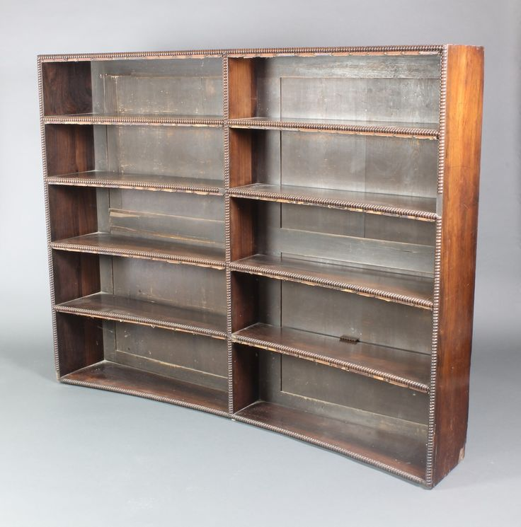 """Lot 1010, A Georgian rosewood concave open bookcase fitted 10 shelves 56""""h x 70""""w x 12""""d, sold for £480"""