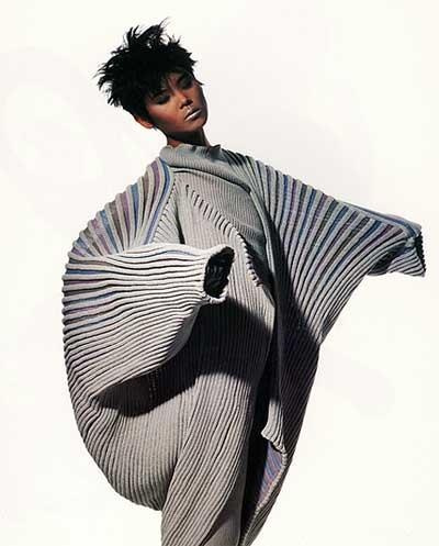 Love this wearable art. Love the movement, texture and architectural design.