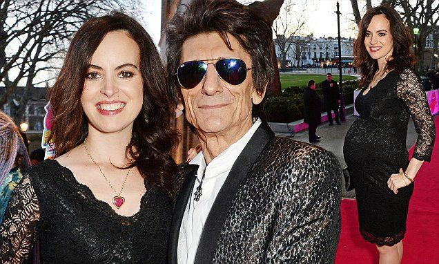 Ronnie Wood's wife Sally shows off growing bump at Stones exhibition