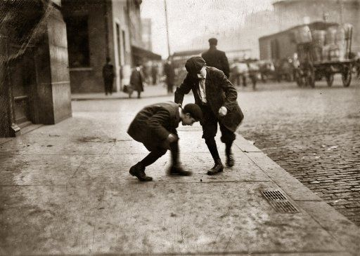 "November 1912. ""Pitching Pennies. Providence, Rhode Island. For Child Welfare Exhibit."" Photograph by Lewis Wickes Hine."