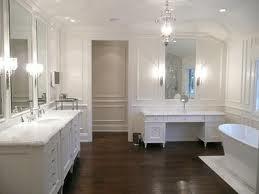 White bathroom, wood floors.