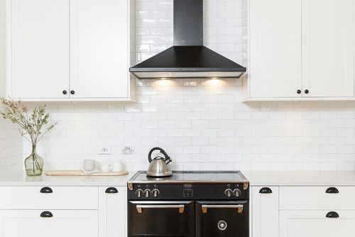 A true minimalist kitchen interior design pairing white cabinetry and splashback with the stunning Belling Black Richmond range cooker. #RangeCookers