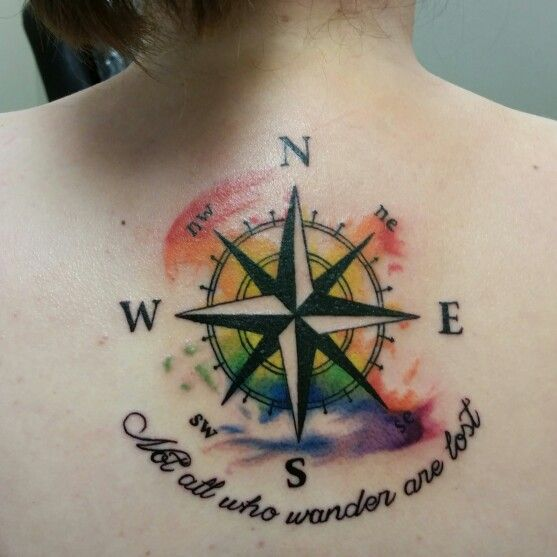 "A little nautical watercolor back tattoo. ""Not all who wander are lost"" Artist : Nic Mann  Shop : Wicked Ways"