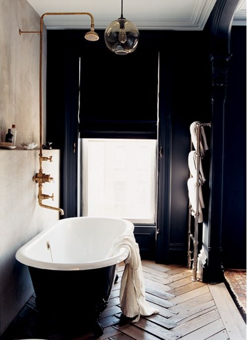 copper plumbing hardware/ towel rack/ wide plank herringbone floor/ lack of shower-head-to-light-fixture clearance