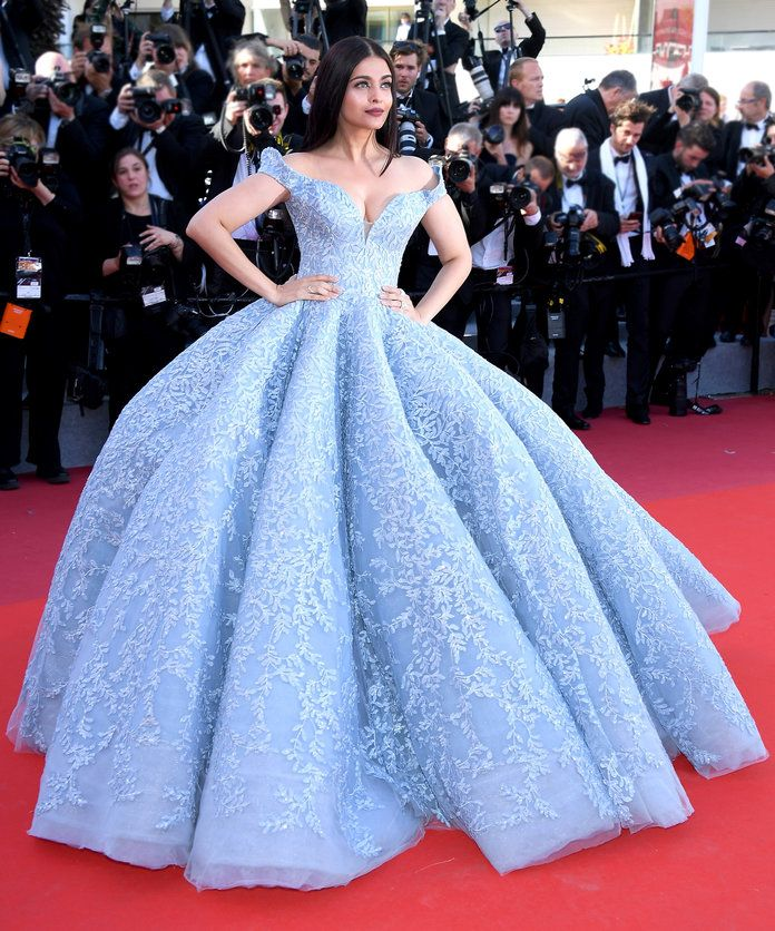 Aishwarya Rai in an ice blue Michael Cinco couture gown with an off-the-shoulder neckline and intricate leafy detailing on the luscious fabric.