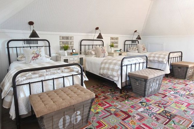 16 clever ways to fit three kids in one bedroom.  I like the uniformity of matching beds