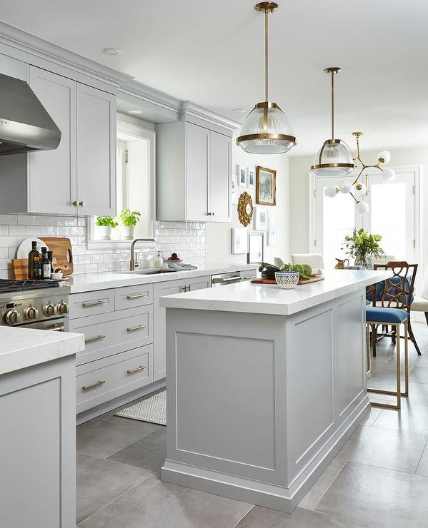 Framed By Gray Staggered Floor Tiles Accented With A Gray And White Runner A Light Gray Island Is White Kitchen Design Kitchen Cabinet Design Kitchen Concepts
