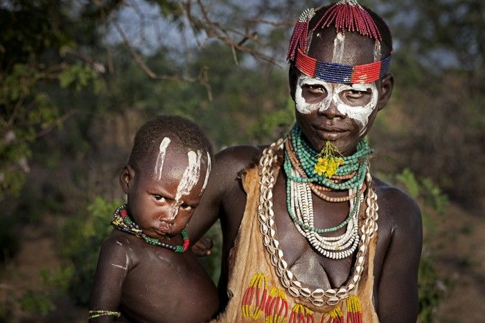 Omo Valley, Ethiopia. A Karo woman with her son. The tribe of Karo live near the Omo river in the south-west of Ethiopia (Africa).
