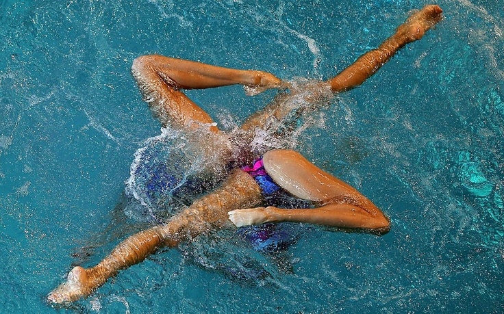 China's Jiang Tingting and Jiang Wenwen compete in the women's synchronised swimming duets qualifications during the 9th Asian Swimming Championships in Dubai
