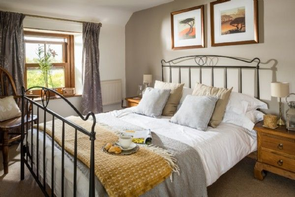 The master bedroom at Seapink Cottage enjoys garden views