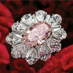 Pink Oval Diamond and colorless diamond ring
