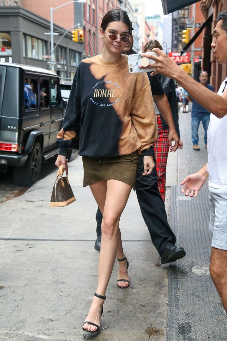 Kendall Jenner wearing Louis Vuitton Monogram Alma Bb Bag, Balenciaga Homme Sweatshirt and Alexander Wang Antonia Sandals