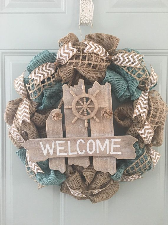 A beach themed wreath!  Light blue and natural burlap accented with a welcome driftwood sign and chevron ribbon.