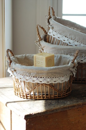 French Country Wicker Baskets...love this idea..add lace to baskets to give that country feel. Gonna do this on my baskets in the bathroom.