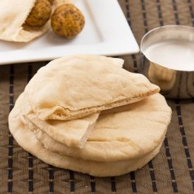 Homemade fluffy pita bread with step by step pictures.
