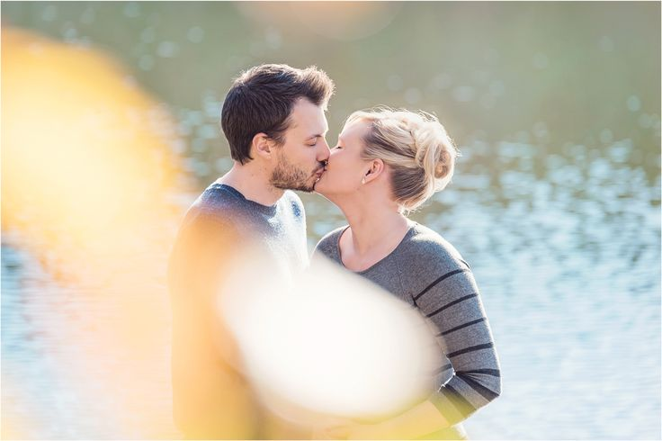 The lake behind us added a great background for this super lovely kiss. Maternity photography, autumn, Adelaide, romantic, couple, pregnancy.