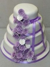 White and Lilac Rose Wedding Cake by Boutique Bakehouse www.boutiquebakehouse.co.uk